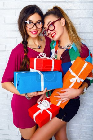 girls friends holding birthday presents