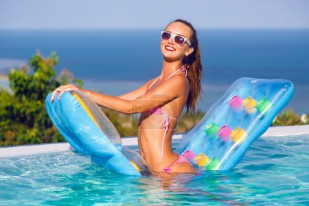 woman in bikini having fun at pool