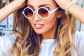 beautiful woman in round sunglasses
