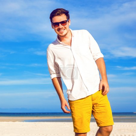 hipster man on amazing tropical beach