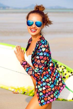surfer girl posing at California beach