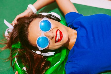 woman wearing mirrored sunglasses and earphones