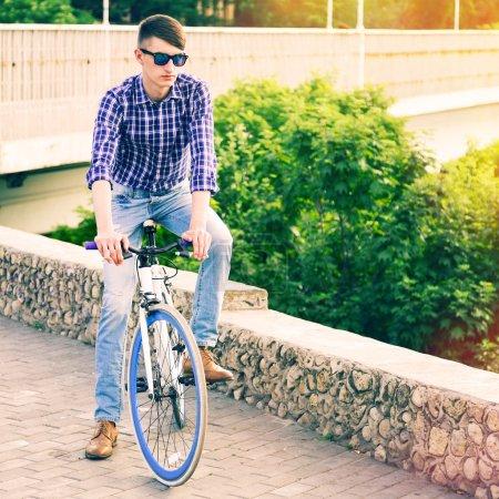 Man riding on blue modern bike