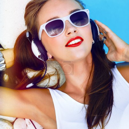 Girl listening and enjoy music on headphones