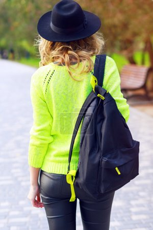 Back view of stylish hipster girl