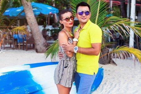 couple in love posing near palms