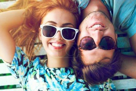 Close up sunny portrait of happy couple