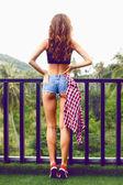 Beautiful hipster woman posing at balcony