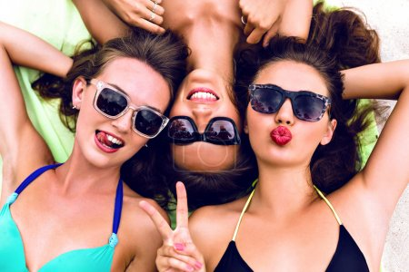 Close up summer portrait of thee girls