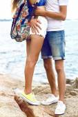 young couple hugging at seaside