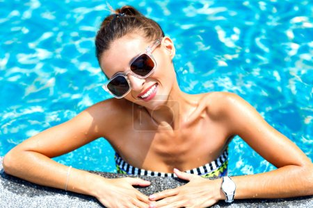 woman relaxed and swimming at pool