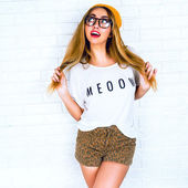 Young hipster girl having fun