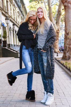 blonde girls having fun on the street