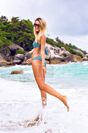 blonde woman on island tropical beach