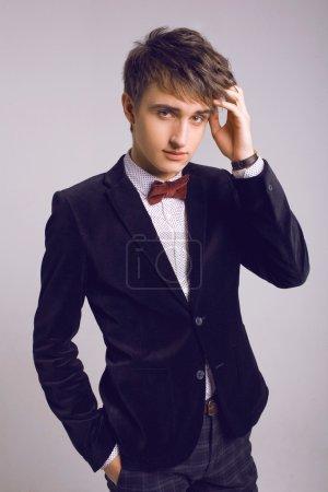 Handsome man in stylish luxury suit