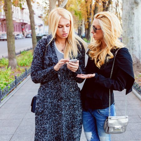 Lifestyle portrait of two blonde girls