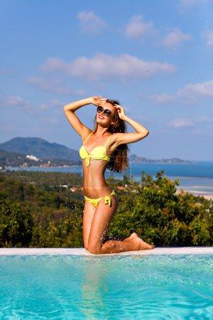 sexy woman posing near pool