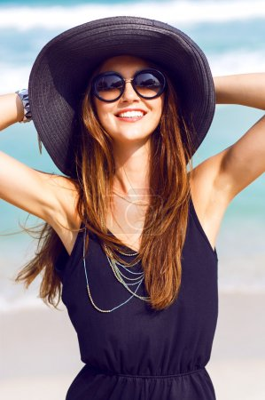 woman wearing vintage hat and sunglasses