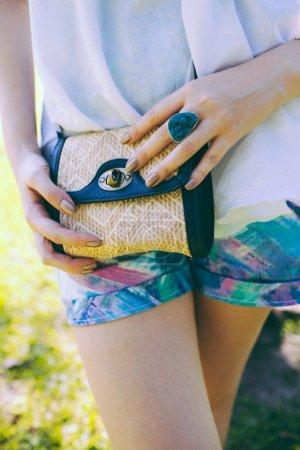 woman holding small vintage bag