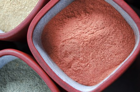 Red cosmetic clay powder
