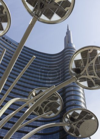 Unicredit tower building in Milan,and a design light pole in the middle