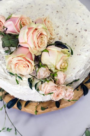 Wedding cake decorated with pink roses