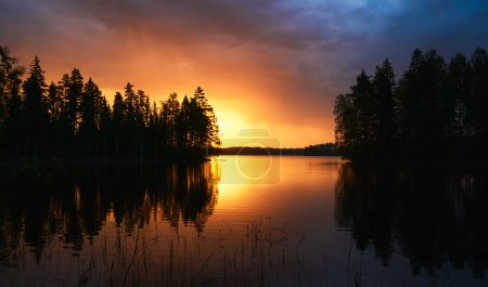 Photo for Finnish landscape at sunset with Lake, sky and trees - Royalty Free Image