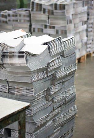 Print shop - Finishing line. Post press finishing line machine: cutting, trimming, paperback