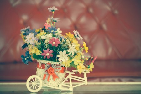 beautiful bouquet of flowers in white basket on table