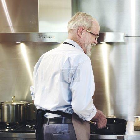 man Cooking at Kitchen