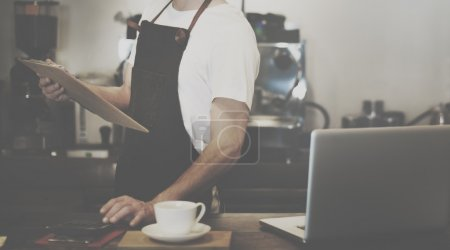 Making Coffee in Barista Cafe