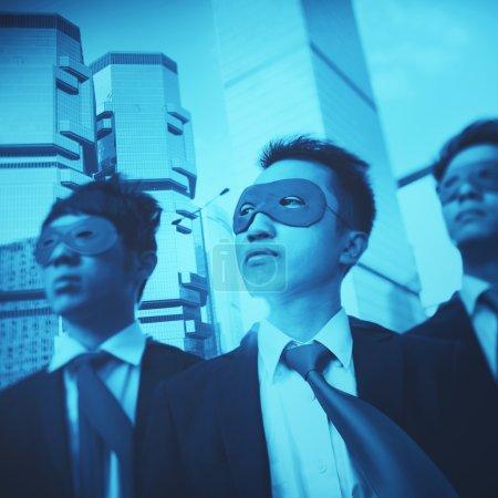 businessmen in superhero masks