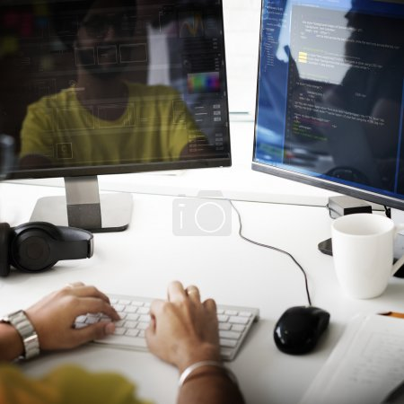 Programmer Working on Computer