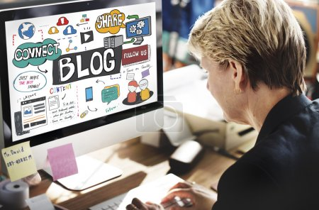 businesswoman looking on monitor with blog