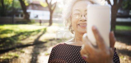senior woman and Online Selfie Concept