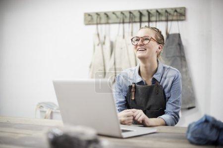 Ceramist Using Laptop