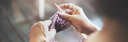 elderly woman crocheting