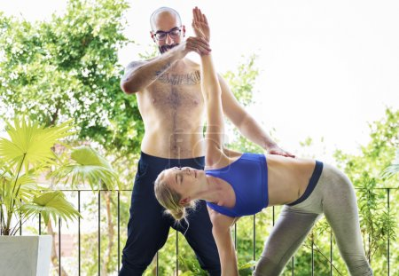 Woman and Man Practicing Pose Yoga