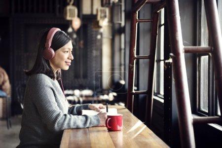 Asian  woman  Listening Song