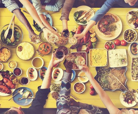friends eating for big table