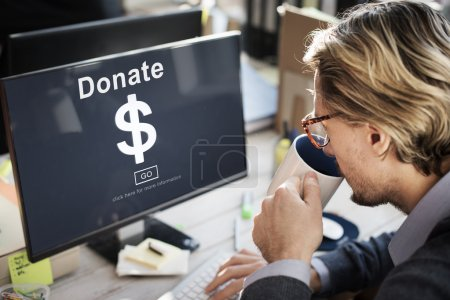 Businessman with donate on monitor