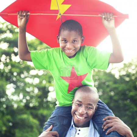 Father and son playing with flying kite
