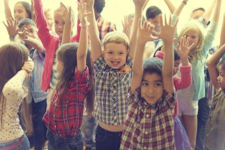 happy children holding hands up