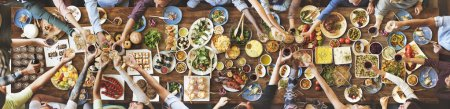 Photo for Diversity friends eating for big table with different food and drink, top view - Royalty Free Image