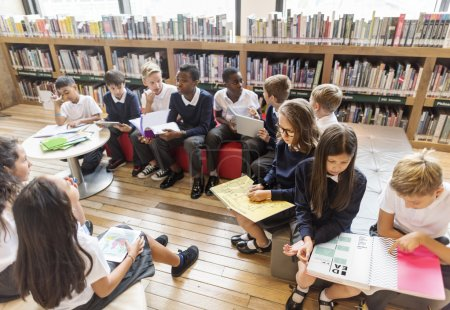 Photo for Classmates reading books in library, Knowledge and Lesson Concept, Original photoset - Royalty Free Image
