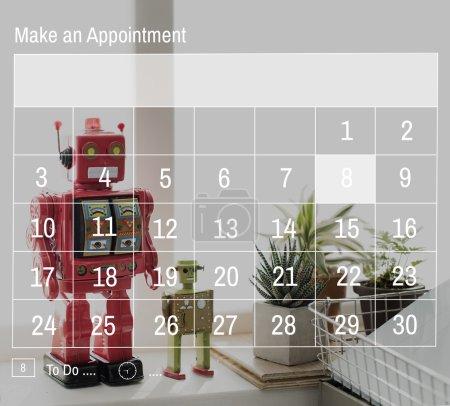 Robots on calendar background