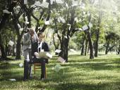 business people posing in nature