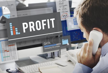 Businessman working on computer with profit