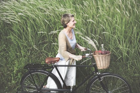 senior woman  with  bicycle outdoor