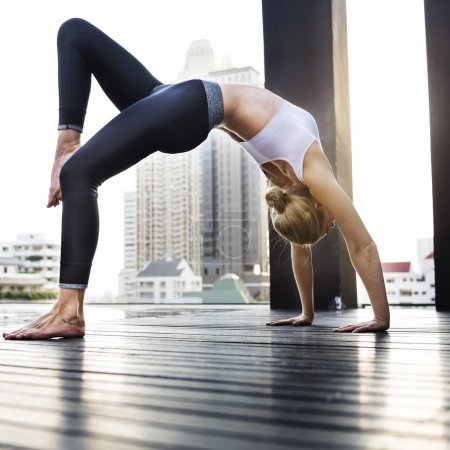 Woman Practicing Pose Yoga